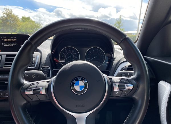 Close up interior steering wheel bmw m235i to win