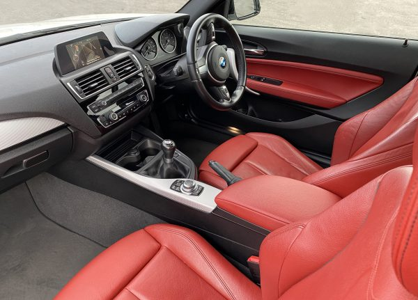 Red leather interior of BMW M235i to WIN